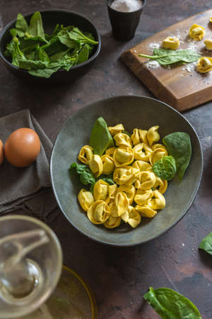 Plate of tortellinis with ricotta and spinach. Typical Italian pasta dish