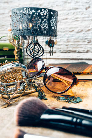 Desk full of accessories for women.