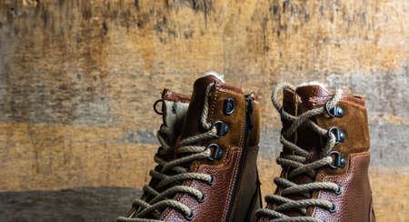 Real leather boots for men. Waterproof boots for walking in the mountains. Hard boots Standard-Bild