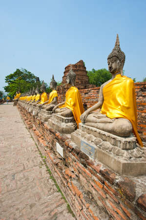 row of buddha image in wat yai chai mongkol, ayutthaya, thailand Stock Photo - 12700396