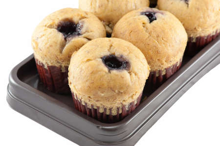 Homemade Blueberry Muffin isolated on white background photo