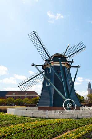 Beautiful Dutch windmill and typical landscape in Japan  photo