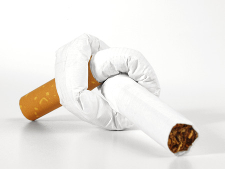 Cigarette with knot on white background