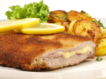 Cordon Bleu with French Fries on white Background 版權商用圖片