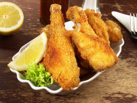 Breaded Chicken Snack on wooden Background Standard-Bild