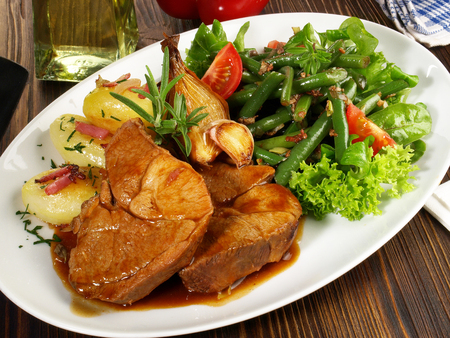 Braised Lamb Meat with Potatoes and Bean Salad Stock Photo