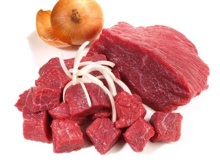Raw Beef Goulash on white Background