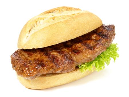 Steak de porc dans un petit pain Banque d'images