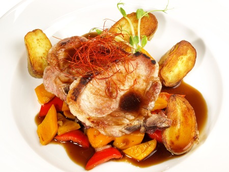 Iberian Pork Loin Steak with roasted Potatoes and red Pepper