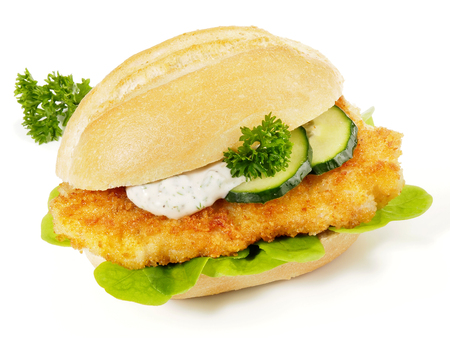 Breaded Schnitzel in a Bun with Sauce and Cucumber