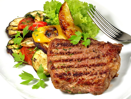 Medium Beef Steak with grilled Vegetables and Barbecue Sauce