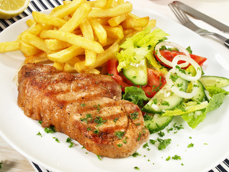 Grilled Pork Loin Steak with French Fries 스톡 콘텐츠