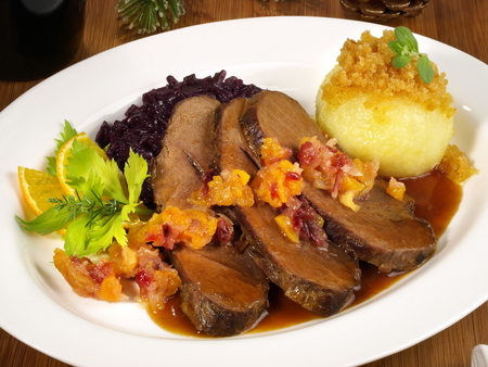 Wild Boar with Potato Dumpling and red Cabbage Stok Fotoğraf