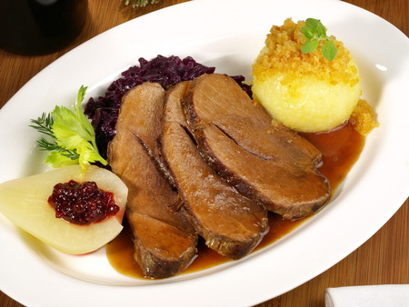 Wild Boar with Potato Dumpling and red Cabbage Standard-Bild