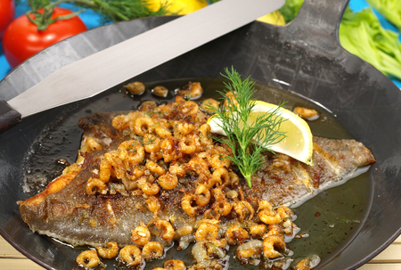 Plaice in a Pan with small Shrimps