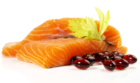 Salmon - Fish Fillet with Omega 3 Capsules  on white Background