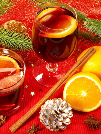 Mulled wine with cinnamon on red background Stock Photo