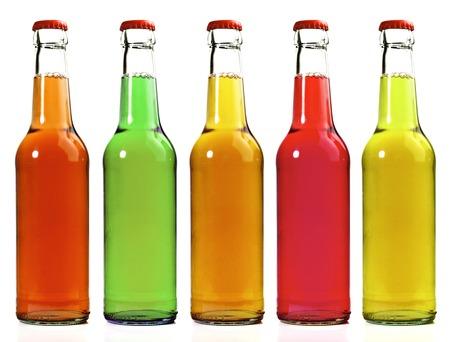 Limonade in Flaschen auf weißem Hintergrund Standard-Bild