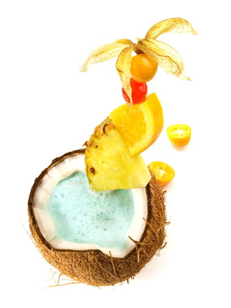 Swimming Pool Cocktail in a Coconut on white Background