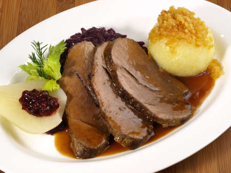 Wild boar with potato dumpling and red cabbage