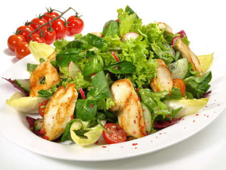 Mixed salad with grilled chicken isolated on white background
