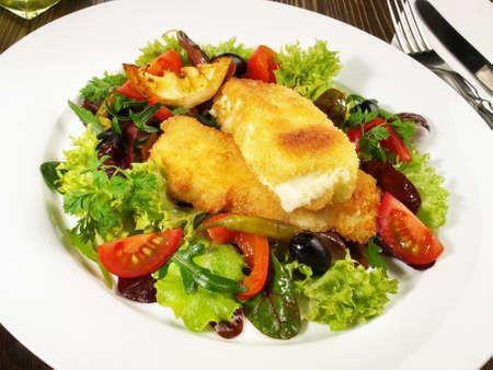Mixed salad with melting Feta Chesse isolated on white background