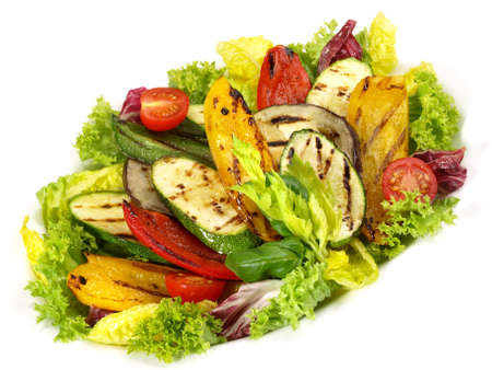 Grilled Vegetables on Mixed Salad isolated on white background