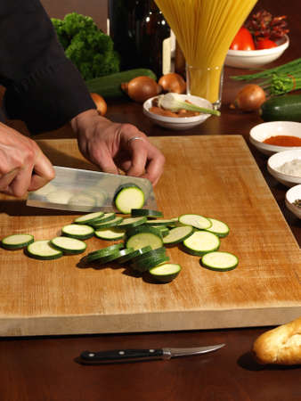 Professional Chefs is preparing Food - Wooden cutting Board
