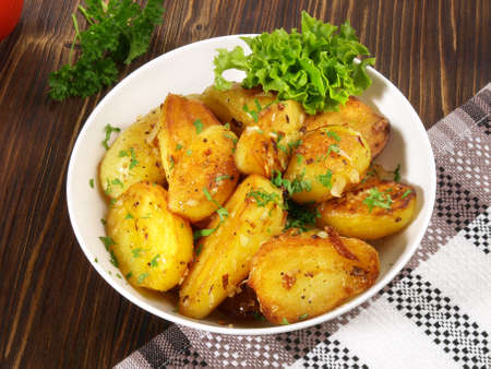Classic Roasted Potatoes with Bacon and Onions in a Bowl