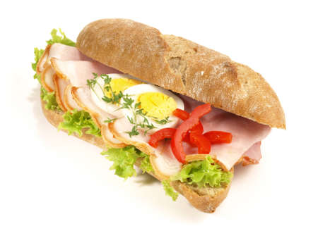Isolated rye baguette with ham and eggs on white background Stock Photo