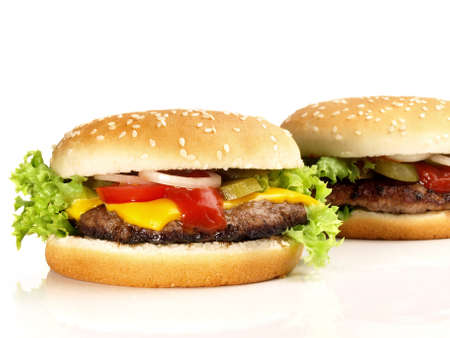 Isolated Grilled Cheeseburger and Hamburger on White Banco de Imagens