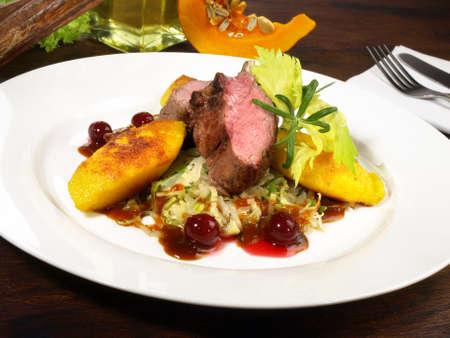 Roe Deer with Vegetables on Cranberry Sauce 版權商用圖片