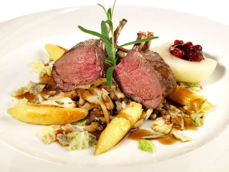 Deer with Vegetables on Cranberry Sauce Isolated