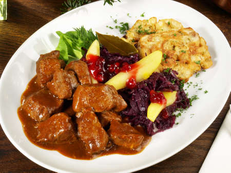 Deer ragout with red cabbage and cranberries