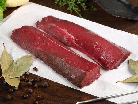 Roe Deer Fillet - Wild Game Meat on wooden background