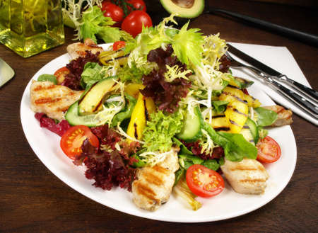 Mixed salad with grilled chicken, avocado and mango