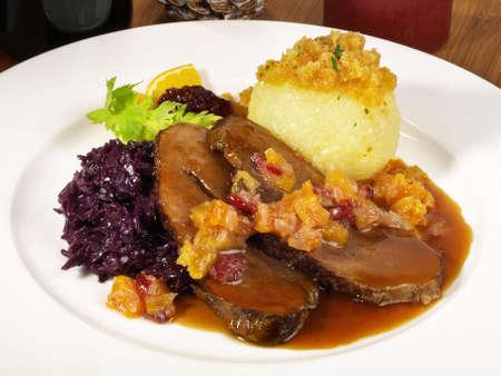 Wild boar with potato dumpling and red cabbage Standard-Bild