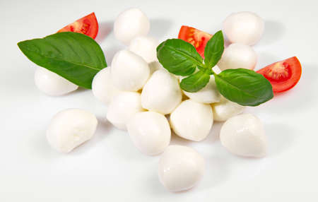 Cherry Tomato with Baby Mozzarella and Basil isolated on white