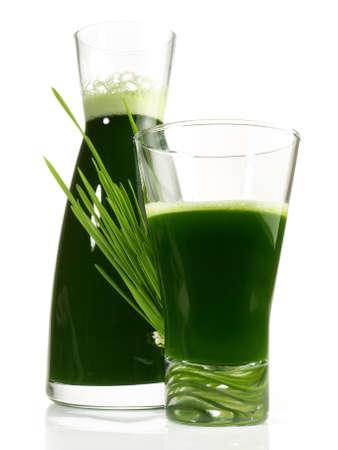 Fresh Wheatgrass Juice isolated on white