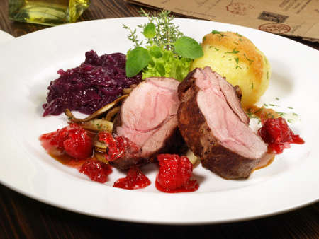 Wild Boar Steak with red Cabbage and Potato Dumpling