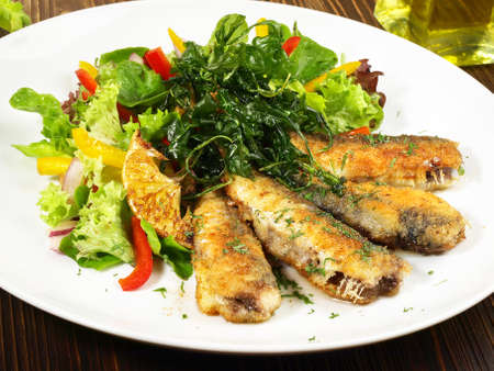 Mixed salad with breaded sardines