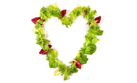 Green salad heart shape isolated on white 版權商用圖片