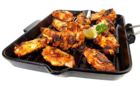 Barbecue - chicken wings on white background