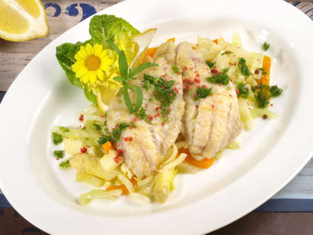 Cooked Gilthead Fillets on white Asparagus Isolated