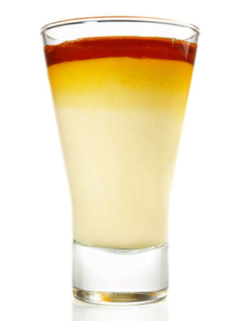 Vanilla Pudding with Caramel in a Glass on white Background - Isolated