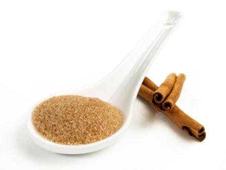 Cinnamon Sugar on a Porcelain Spoon - Isolated 版權商用圖片
