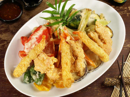Fast Food - Vegetable Tempura with Soy and Dipping Sauce on wooden Background.