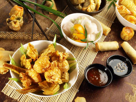 Dim Sum - Chinese Snack on wooden background.