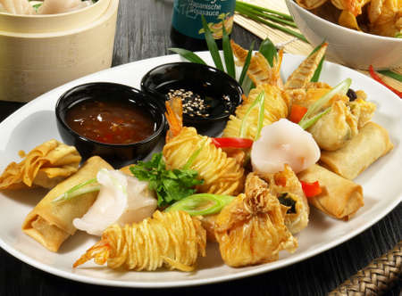 Dim Sum - Fried and Steamed Chinese Snack on wooden Background. 版權商用圖片