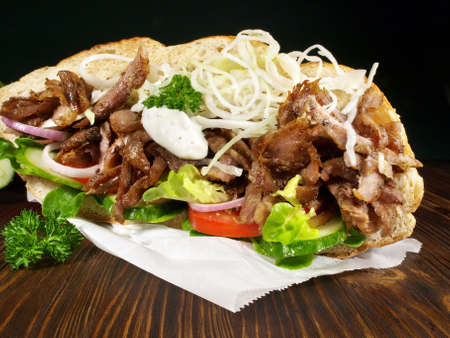 Kebab Sandwich with Grilled Meat on wooden background. 版權商用圖片